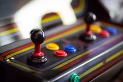 Joystick of a vintage arcade videogame - Coin-Op. A view of a Joystick of a vintage arcade videogame - Coin-Op Royalty Free Stock Photo