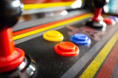 Joystick of a vintage arcade videogame - Coin-Op. A view of a joystick of a vintage arcade videogame - Coin-Op Royalty Free Stock Image