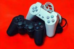 Joysticks. Close up of two joysticks on red background Stock Photos
