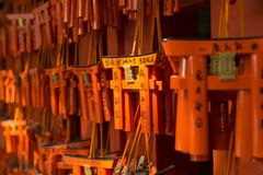 Kyoto Fushimi Inari Shrine ema. Ema (wooden plaque for prayers and wishes) in form of an orange torii (gate) at the world famous fushimi Stock Image