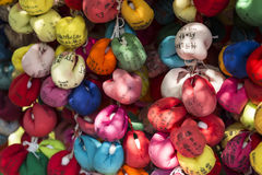 Kyoto colorful temple charms. Unusual ema (wooden plaque for prayers and wishes) in form of colorful and squishy balls made of cloth at a temple in Kyoto, Japan Royalty Free Stock Image