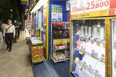 Tokyo Akihabara computer smart phone shop. View on a shop window with phones and tablet personal computers at night in Akihabara, Tokyo, Japan Royalty Free Stock Photo