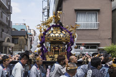 Sanja matsuri festival at the asakusa temple in tokyo japan. A portable shrine is being carried through the streets around the senso-ji temple during the sanja Royalty Free Stock Photo