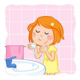 Kids - daily routine actions -cute little girl with ginger hair washing her face Royalty Free Stock Photography