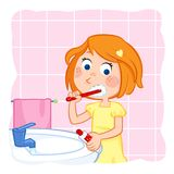 Routine actions - tooth brushing - cute little girl with ginger hair Stock Photography