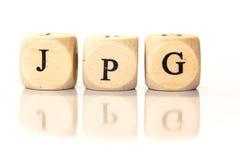 JPG buchstabierte Wort, Würfelbuchstaben mit Reflexion Lizenzfreies Stockfoto
