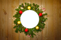 Christmas Round Frame with firtree, candies and baubles Stock Images