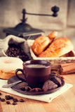 Jpg2014102813575631838 Cup coffee with grain and croissants Stock Photo