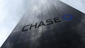 JPMorgan Chase Bank logo on a skyscraper facade reflecting clouds. Editorial 3D rendering Stock Photos