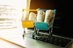 JPY and EURO money in trolley on laptop keyboard. Idea of exchan. Ge money online shopping, Online shopping is form of e-commerce, consumers to buy goods from Royalty Free Stock Photography