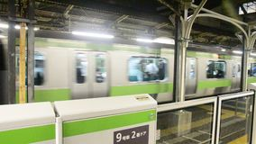 JR yamanote line of train tokyo metro stop receive people and run go to around Tokyo city at Nippori railway station. TOKYO, JAPAN - OCTOBER 18 : JR yamanote stock video footage