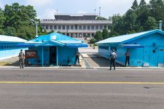JSA within DMZ, Korea - September 8 2017: UN soldiers in front of blue buildings at North South Korean border with North Korean to Royalty Free Stock Image