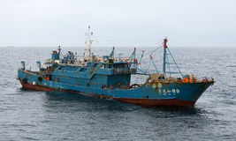 JU LONG JIA YA fishing vessel No.9. Pacific Ocean – October 30th, 2015: The Pacific Ocean, 300 nautical miles to the East from the Japanese island of Hokkaido Royalty Free Stock Images