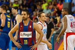 Juan Carlos Navarro joga a equipa de basquetebol de TAU Vitoria dos againts Fotografia de Stock