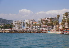 Juan-les-Pins, FRANCE - AUG 28, 2014: Coastline on the public beach Stock Images