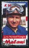Juan Manuel Fangio. Malawi - CIRCA 2012: stamp printed by Malawi, shows Juan Manuel Fangio, circa 2012 royalty free stock photo