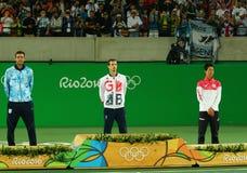 Juan Martin Del Porto ARG L, Olympic champion Andy Murray GBR and Kei Nishikori JPN during tennis men`s singles medal ceremony Stock Photos