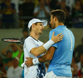 Juan Martin Del Potro R congratulates Olympic champion Andy Murray of Great Britain with his victory at men`s singles final Royalty Free Stock Images