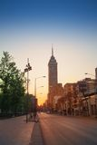 Juarez Avenue in morning sunlight view to east. Juarez Avenue towards Latin America tower in Mexico downtown in sunrise summer sun Royalty Free Stock Photos