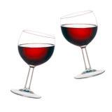 Jubel! Två exponeringsglas av rött vin, vippat på som isoleras på vit backg Royaltyfri Bild