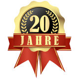 Jubiläumknopf mit Fahne und Bänder für 20 Jahre Lizenzfreies Stockfoto