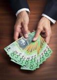 Jubilación de los dólares del dinero del asunto de las manos Imágenes de archivo libres de regalías