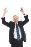 Jubilant affärsman med lyftta armar royaltyfri bild