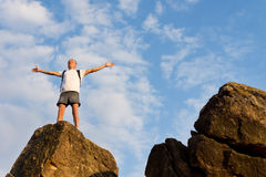 Jubilant backpacker on top of a mountain Stock Image