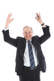Jubilant businessman with arms raised. Jubilant middle-aged businessman with a wide smile and his arms raised above his head to show his elation Royalty Free Stock Image