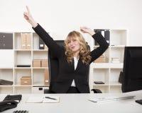 Jubilant businesswoman celebrating Royalty Free Stock Photos