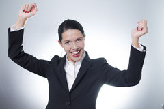 Jubilant businesswoman cheering Royalty Free Stock Photography