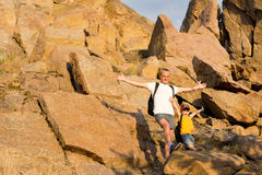 Jubilant father and son on a mountainside Stock Photo
