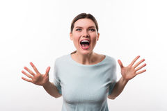 Jubilant girl standing isolated on white background. Express yourself. Positive overjoyed pretty girl opening her mouth and holding her palms in front of her Royalty Free Stock Photos