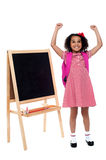 Jubilant little girl in school uniform Stock Photo