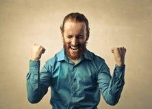 Jubilant man. Celebrating his success Royalty Free Stock Photo