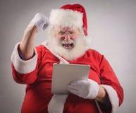 Jubilant technological Santa Claus Royalty Free Stock Photos