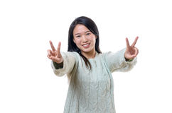 Jubilant triumphant young woman making V-signs stock images
