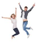 Jubilant young man and woman. Jubilant young men and women leaping high in the air for joy with their arms raised isolated on white Stock Photography