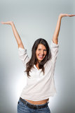 Jubilant young woman cheering her success. Raising her arms in the air in excitement and elation at her achievement or victory Royalty Free Stock Image