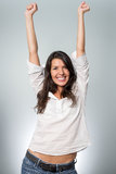 Jubilant young woman cheering her success Stock Photo