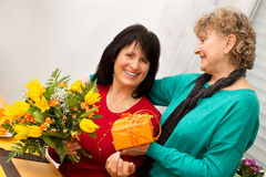 Jubilarian. Woman is bestowed by her driend Royalty Free Stock Image