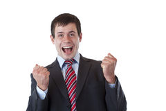 Jubilates dell'uomo d'affari soddisfatti dei pugni chlenched immagine stock