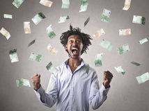 Jubilating businessman. With a lot of money Royalty Free Stock Image