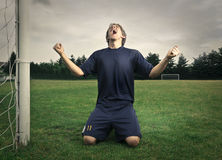 Jubilating Footballer. A young boy who plays football is jubilating Stock Images