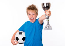 Jubilation boy with ball and cup. Jubilation blond boy with ball and cup stock photos