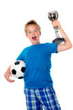 Jubilation boy with ball and cup. Jubilation blond boy with ball and cup royalty free stock images