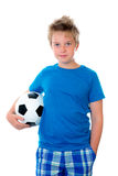 Jubilation boy with soccer ball. Nice blond boy with ball royalty free stock images