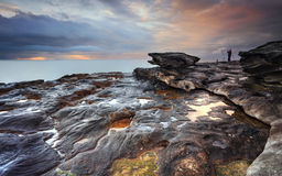 Jubilation skies at South Curl Curl. The view south from South Curl Curl rocks, NSW Australia. The rock really grabbed my eye and this was where the most colour stock photography