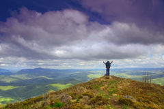 Jubilation on the top. Man reached the top of the mountains. He's jubilating with hands up royalty free stock photos