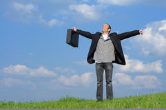 Jubilation / triumph. Young man with briefcase in nature is very happy stock photos
